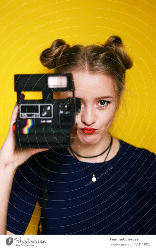Young woman with an instant camera Lifestyle Style Feminine Youth (Young adults) Woman Adults 1 Human being 18 - 30 years Creativity Beautiful Photography