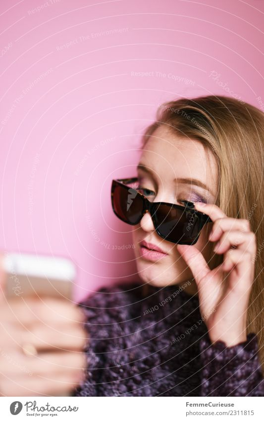 Girl with sunglasses taking a self portrait with smartphone Lifestyle Elegant Style Technology Entertainment electronics Feminine Young woman