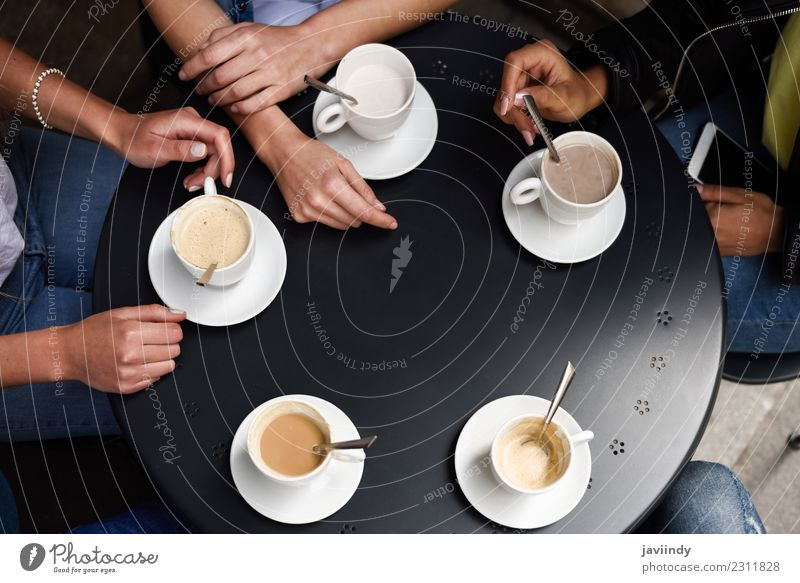 Hands with coffee cups on table in a urban cafe. Breakfast Beverage Coffee Lifestyle Shopping Table Meeting To talk Friendship Group Heart Together Hot Brown