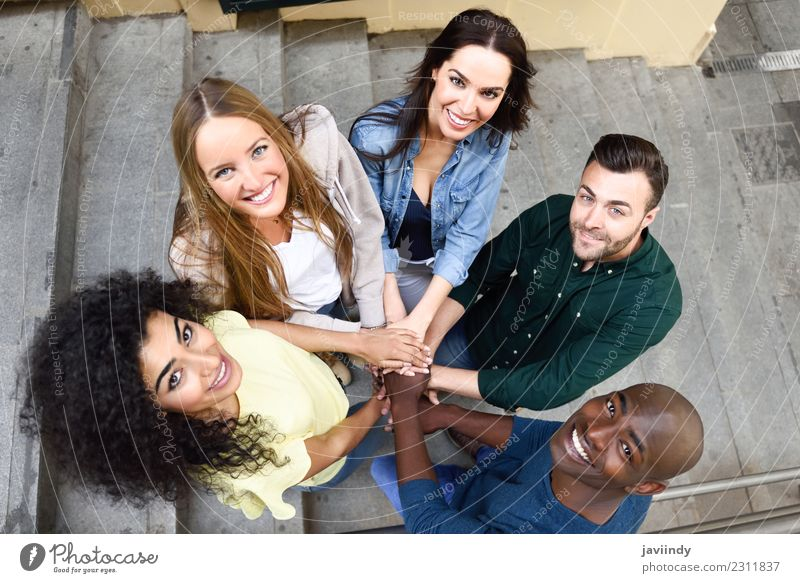 Top view of young people putting their hands together. Woman Human being Youth (Young adults) Man Young woman Young man White Hand Joy 18 - 30 years Black