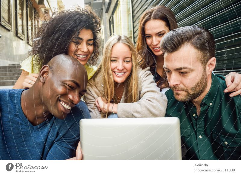 Young people looking at a tablet computer outdoors Woman Human being Youth (Young adults) Man Young woman Beautiful Young man Joy 18 - 30 years Adults Street