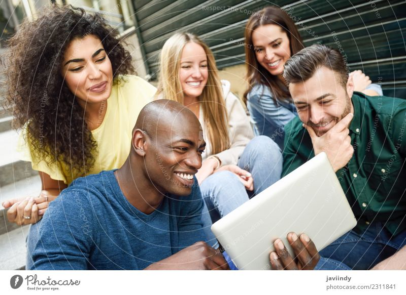 Group of young people looking at a tablet computer Lifestyle Joy Happy Beautiful Young woman Youth (Young adults) Young man Woman Adults Man Friendship 5
