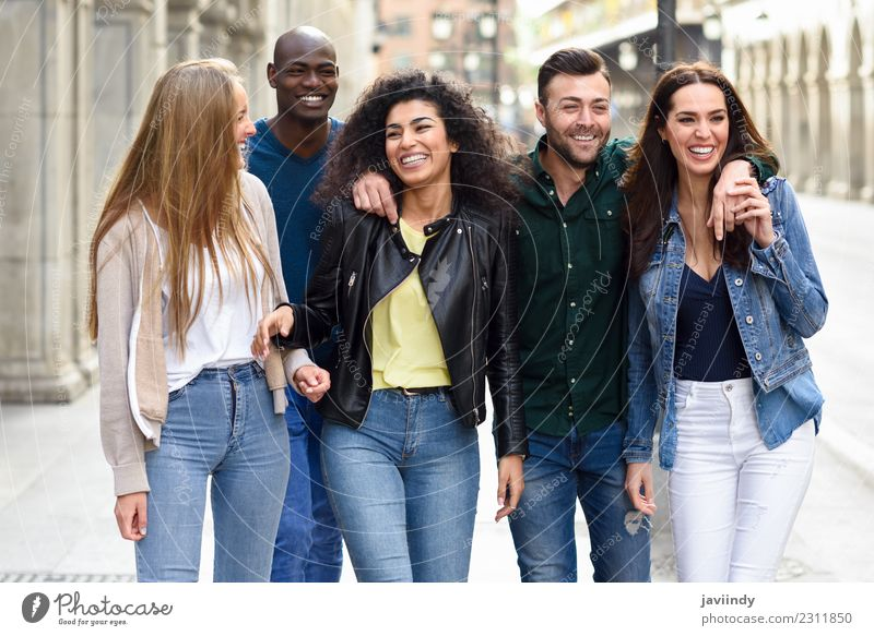 Multi-ethnic group of young people having fun together Lifestyle Joy Young woman Youth (Young adults) Young man Woman Adults Man Friendship 5 Human being Group