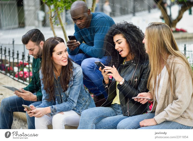 Multi-ethnic group of young people using smartphone Lifestyle Joy Summer Telephone Computer Technology Human being Young woman Youth (Young adults) Young man
