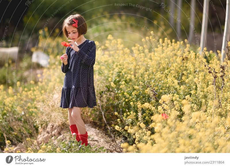 Little girl in nature wearing dress with a poppy in her hand. Child Woman Human being Nature Summer Beautiful Flower Joy Girl Adults Lifestyle Meadow Grass