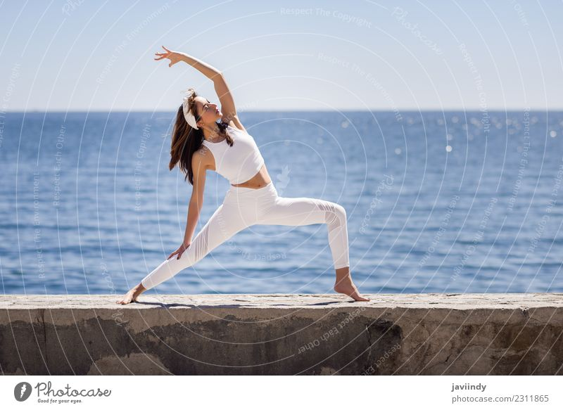 Young woman doing yoga in the beach. Woman Human being Nature Youth (Young adults) Summer Beautiful White Ocean Relaxation Calm Beach 18 - 30 years Adults