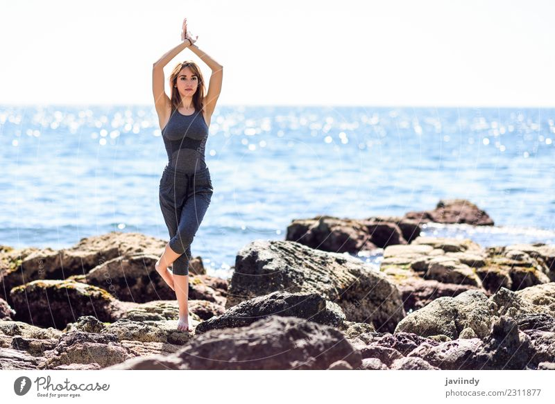 Young woman doing yoga in the beach. Woman Human being Nature Youth (Young adults) Relaxation Calm Beach 18 - 30 years Adults Lifestyle Sports Health care
