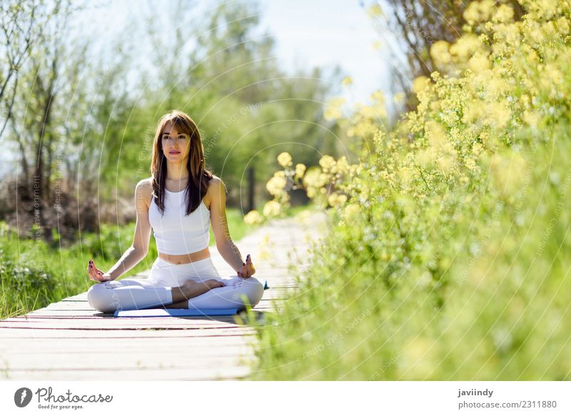 Young woman doing yoga on wooden road in nature. Lifestyle Beautiful Body Relaxation Meditation Summer Sports Yoga Human being Young man Youth (Young adults)