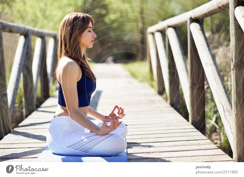 Woman doing yoga in nature. Lotus figure on wooden bridge. Lifestyle Beautiful Body Relaxation Meditation Summer Sports Yoga Human being Young woman