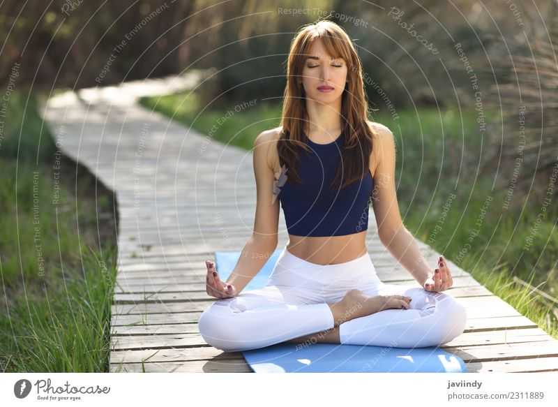 Young woman doing yoga in nature. Lotus figure. Woman Human being Nature Youth (Young adults) Summer Beautiful White Relaxation Calm 18 - 30 years Adults