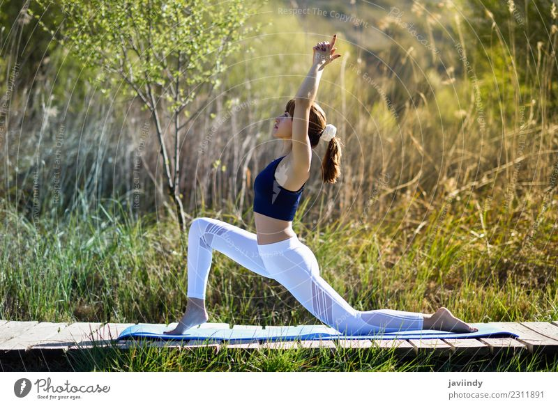 Young Woman Doing Yoga In Nature A Royalty Free Stock Photo From Photocase