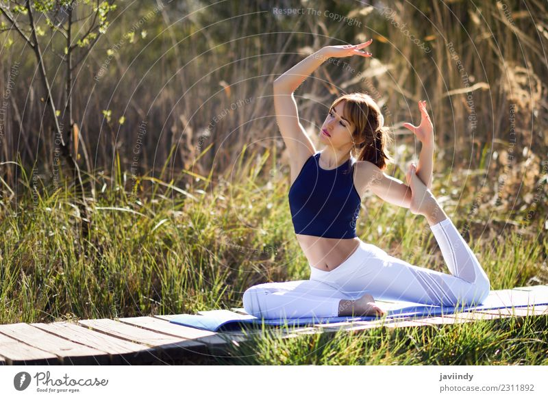 Young woman doing yoga in nature. Lifestyle Beautiful Body Wellness Relaxation Meditation Sports Yoga Human being Youth (Young adults) Woman Adults 1