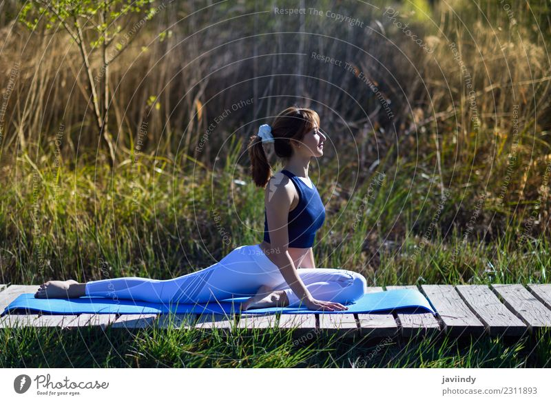 Young woman doing yoga in nature. Lifestyle Beautiful Body Relaxation Meditation Summer Sports Yoga Human being Youth (Young adults) Woman Adults 1