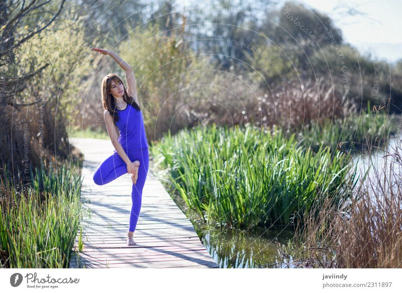 Young woman doing yoga in nature. Lifestyle Happy Beautiful Body Relaxation Meditation Summer Sports Yoga Human being Youth (Young adults) Woman Adults 1