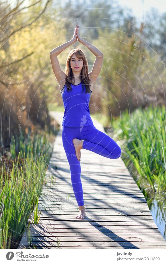 Young woman doing yoga in nature Lifestyle Beautiful Relaxation Meditation Summer Sports Yoga Human being Youth (Young adults) Woman Adults 1 18 - 30 years