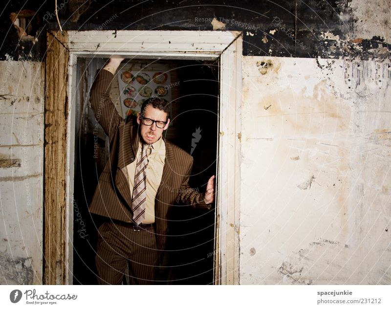 Human being Man Adults Dark Wall (building) Wall (barrier) Brown Dirty Masculine Crazy Exceptional Threat Eyeglasses Uniqueness Anger Suit