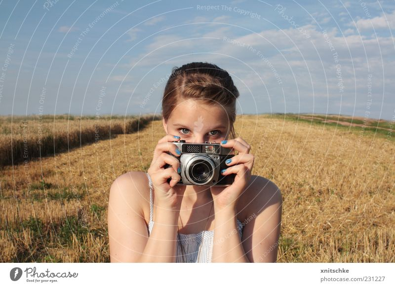 Youth (Young adults) Blue Hand Summer Clouds Eyes Yellow Feminine Landscape Head Field Photography Observe To hold on Curiosity Camera