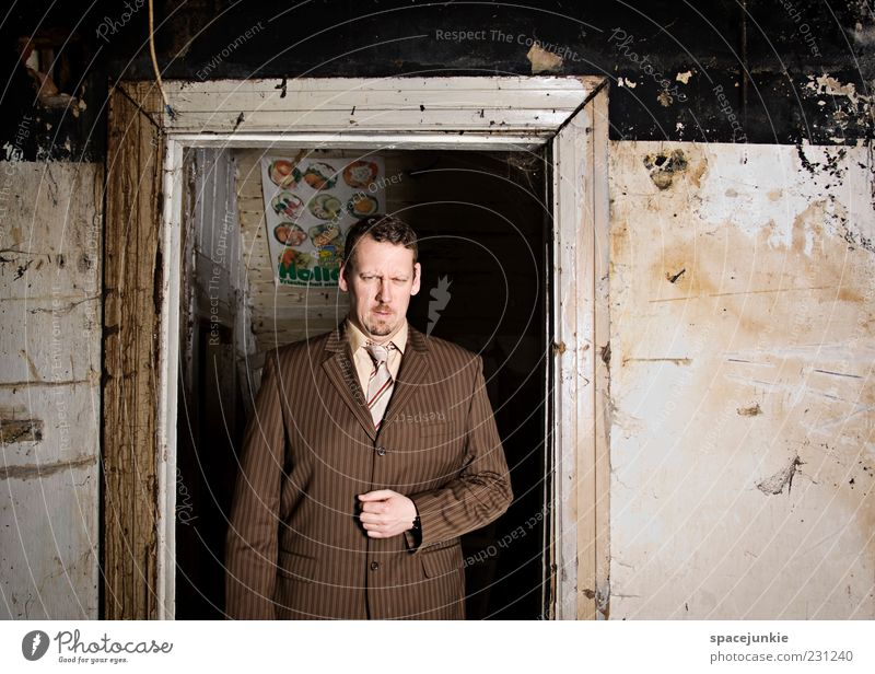 Human being Man Adults Wall (building) Wall (barrier) Brown Door Dirty Elegant Masculine Might Threat Observe Derelict Anger Suit