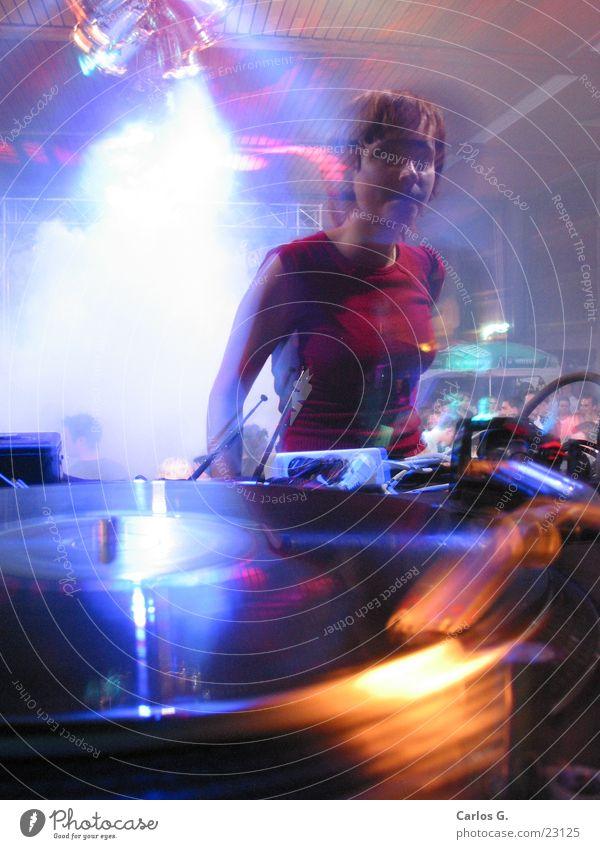 danci'n girl 1 Party Long exposure Techno Disco Night life Dance electro Disc jockey Record player Motion blur Young woman Party goer Interior shot Flare
