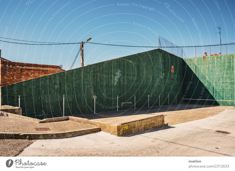 playground Town Deserted Places Playground Wall (barrier) Wall (building) Facade Blue Brown Green Red Concrete Lantern Mesh grid Boundary Shadow play