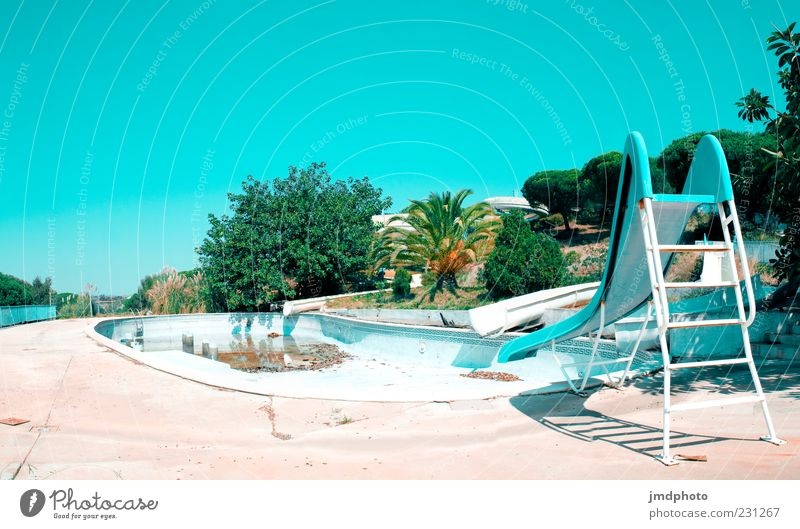 Slide and Pool Summer Swimming pool Beautiful weather Warmth Drought Old Dirty Exotic Hot Bright Blue Green White Relaxation Decline Transience Colour photo