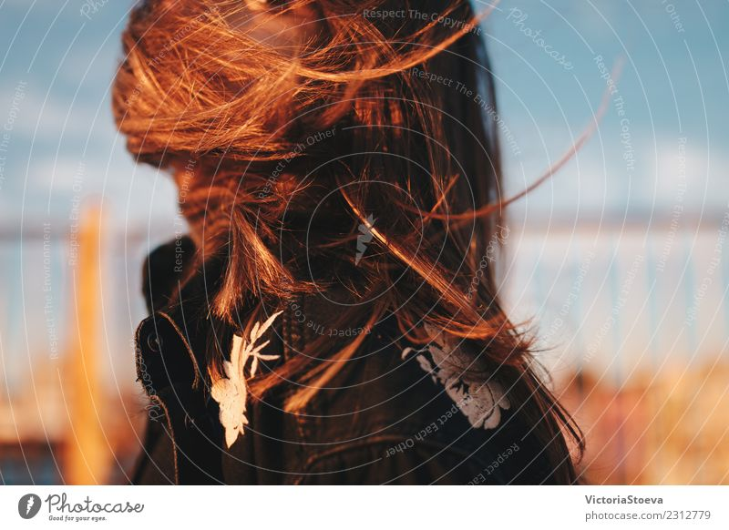 Windy hair on face. Sunset. golden hour Lifestyle Style Young woman Youth (Young adults) Hair and hairstyles 1 Human being 18 - 30 years Adults Jacket Brunette
