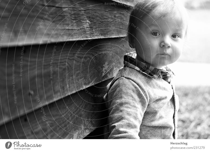Human being Child Beautiful Life Head Infancy Authentic Uniqueness Toddler Cheek Wooden wall Black & white photo Face of a child