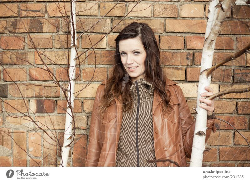 wall Feminine Young woman Youth (Young adults) Woman Adults 1 Human being 18 - 30 years Tree Birch tree Wall (barrier) Wall (building) Jacket Leather Brunette