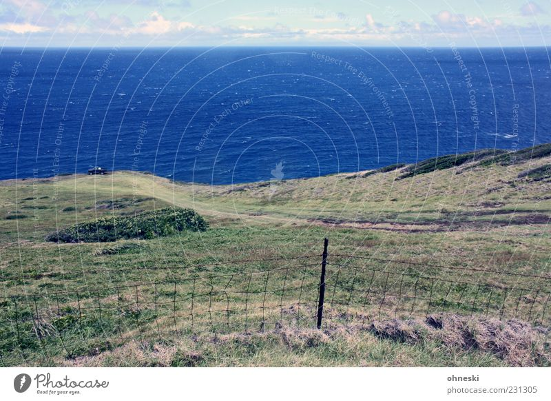 parking space Environment Nature Landscape Earth Water Sky Clouds Grass Waves Coast Ocean Pacific Ocean Hawaii Maui Blue Far-off places Fence Colour photo