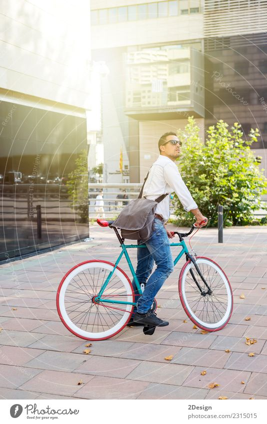 A young stylish man posing next to his bicycle. Youth (Young adults) Man White Relaxation Adults Street Sports Fashion City life Stand Smiling Youth culture