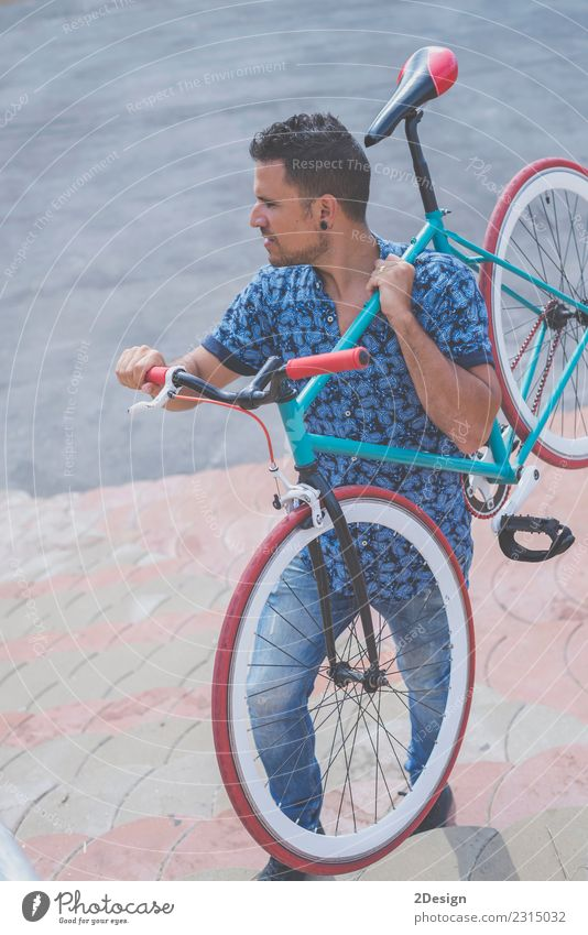 Urban man holding his bike casual wearing Human being Sky Man Blue Red Adults Street Lifestyle Style Happy Copy Space Friendship Leisure and hobbies Retro Stand