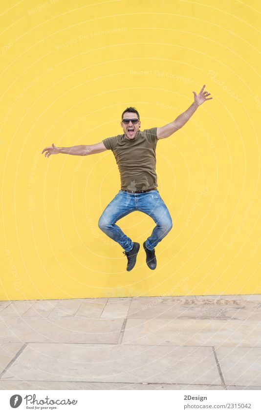Young man with sunglasses jumping Lifestyle Joy Freedom Human being Youth (Young adults) Man Adults T-shirt Jeans Sunglasses Movement Jump Authentic Uniqueness