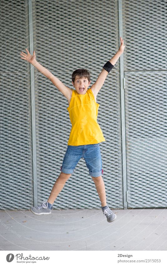 A young teen jumping Lifestyle Joy Freedom Summer Sports Success Child Boy (child) Man Adults Youth (Young adults) Arm Meadow Clothing Jeans Movement Flying