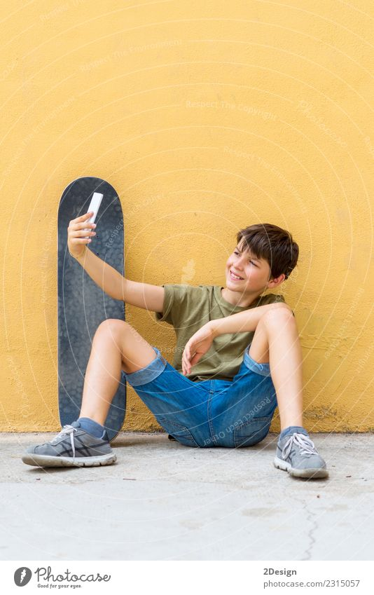 Young teen selfie with skateboard sitting on the floor Child Man Summer Sun Relaxation Joy Adults Street Lifestyle Spring Boy (child) Freedom Sit Action Smiling