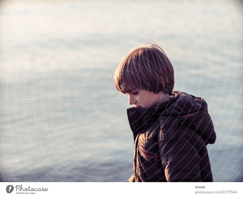 Boy at the lake Healthy Child Schoolchild Human being Masculine Boy (child) Infancy 1 8 - 13 years Nature Landscape Water Climate Weather Lake Jacket Coat