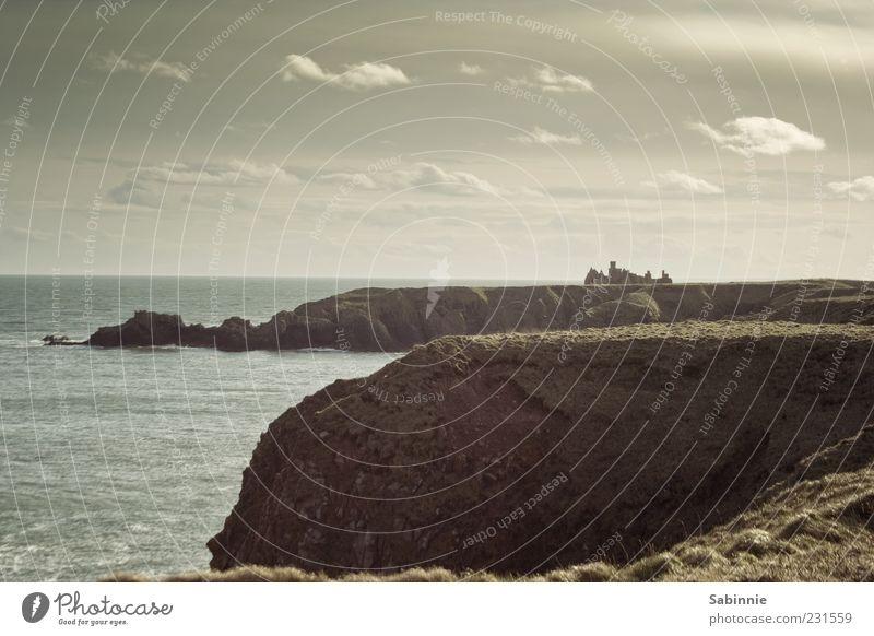 Sky Nature Blue Water Ocean Beach Clouds Far-off places Landscape Stone Coast Building Brown Horizon Waves Wind