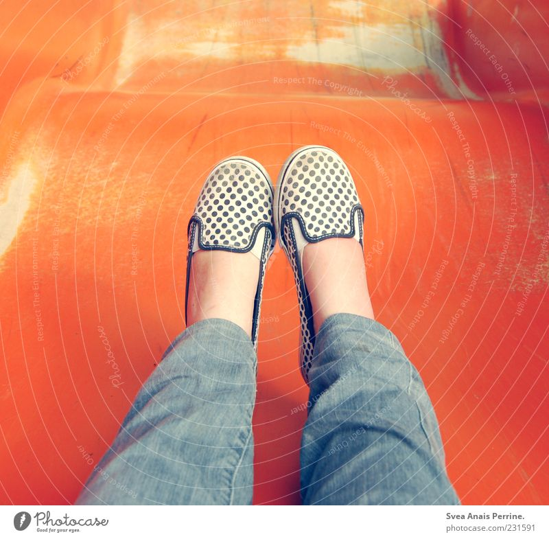 Human being Youth (Young adults) Feminine Playing Legs Feet Footwear Sit Beginning Childhood memory Jeans Young woman Joie de vivre (Vitality) Playground Slide Spotted