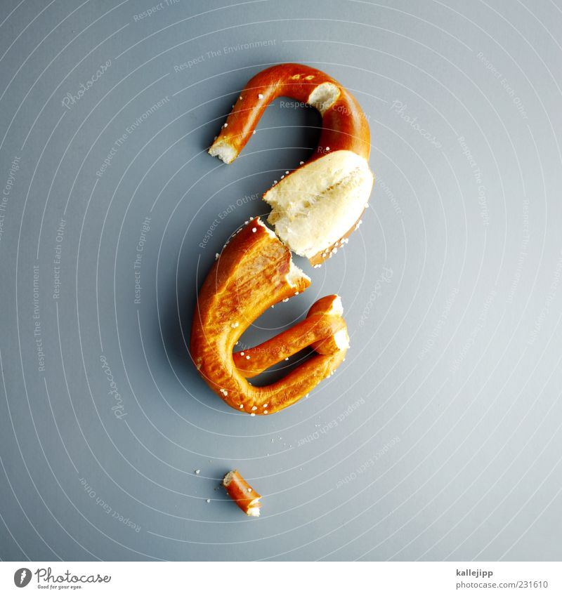 puzzle Food Nutrition Vegetarian diet Sign Characters Education ? Question mark Ask Puzzle Pretzel Soft pretzel Salt Problem solving Colour photo Studio shot