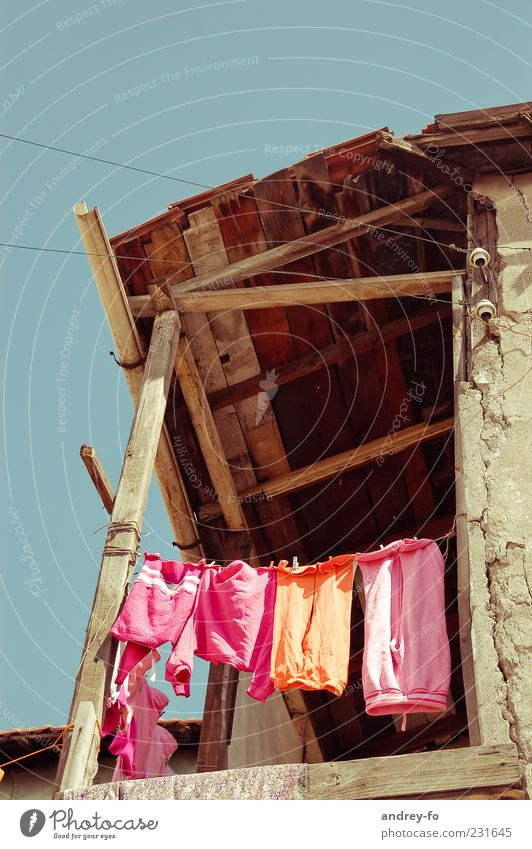 Drying laundry Village Ruin Wall (barrier) Wall (building) Balcony Terrace Roof Clothing Pants Hang Poverty Small Above Clean Multicoloured Pink Infancy Life