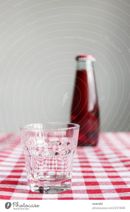 red soda Beverage Drinking Cold drink Lemonade Juice Bottle Glass Red Checkered Thirsty Tasty Sense of taste Blur Small Colour photo Interior shot Reflection