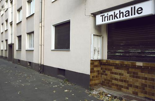 booths House (Residential Structure) Drinking Town Facade Window Gloomy Sidewalk Kiosk Closed Apartment house Lettering Billboard Spirits The Ruhr built