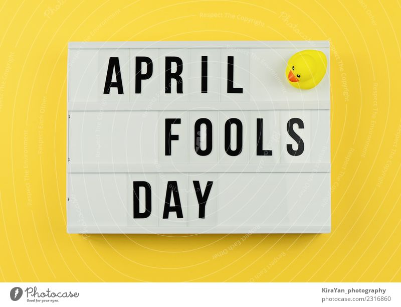 Text April Fool's day in light box on yellow Joy Entertainment Feasts & Celebrations Spring Toys Box Smiling Laughter Funny Yellow Moody Optimism Friendship