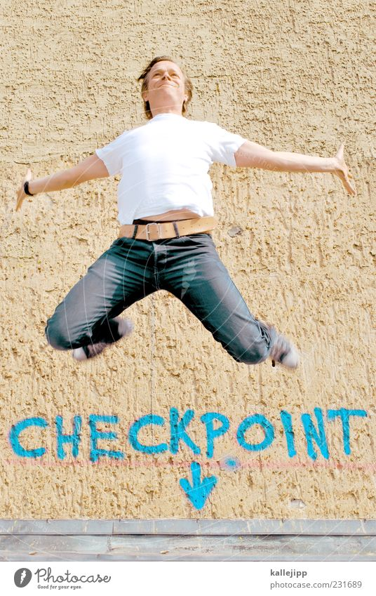 checkpoint charlie Human being Masculine Man Adults 1 30 - 45 years T-shirt Jeans Sneakers Jump Checkpoint Charlie Arrow Signs and labeling Graffiti