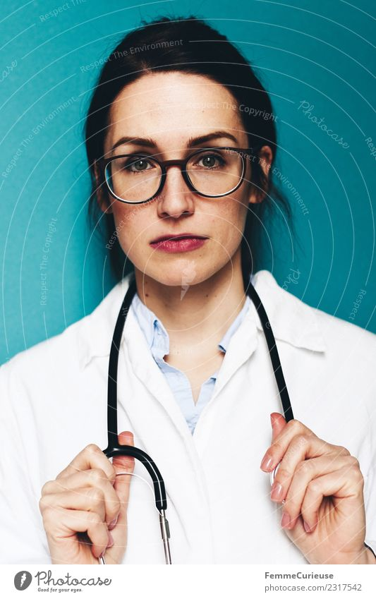 Female doctor with stethoscope and lab coat Work and employment Profession Doctor Feminine Young woman Youth (Young adults) Woman Adults 1 Human being