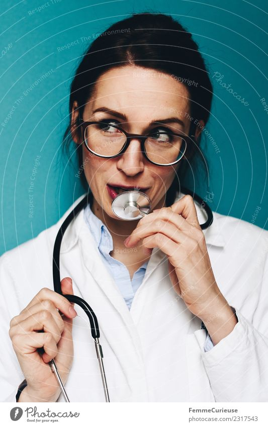 Female, friendly doctor fooling around with her stethoscope Work and employment Profession Doctor Feminine Young woman Youth (Young adults) Woman Adults 1
