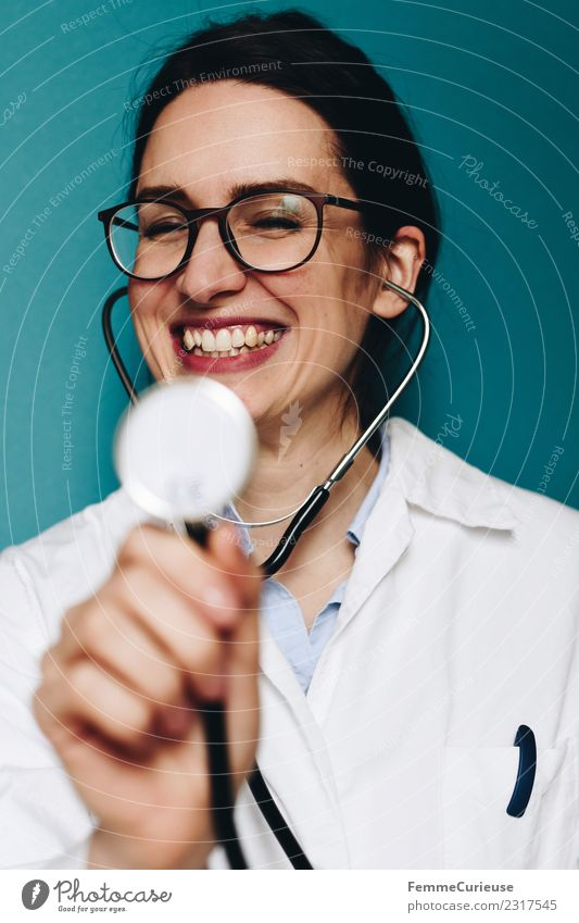 Female doctor fooling around with her stethoscope Work and employment Profession Doctor Feminine Young woman Youth (Young adults) Woman Adults 1 Human being