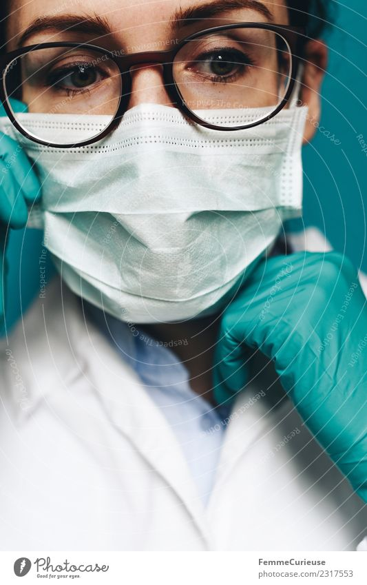 Female doctor with face mask, protective gloves and lab coat Work and employment Profession Doctor Feminine Young woman Youth (Young adults) Woman Adults 1