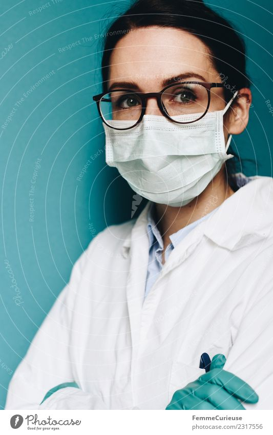 Female doctor wearing a face mask and protective gloves Work and employment Profession Doctor Feminine Young woman Youth (Young adults) Woman Adults 1