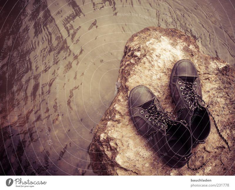 walk in my shoes! Water Footwear Stone Deserted Copy Space left Deep depth of field Bird's-eye view Pair of shoes Brown