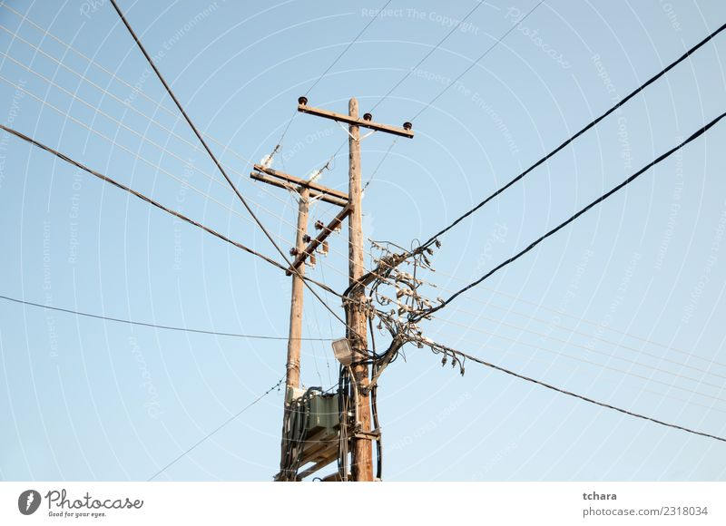 Old fashion electric transmission network Industry Business Technology Environment Sky Wood Metal Steel Line Bright Blue Energy Colour tower electricity